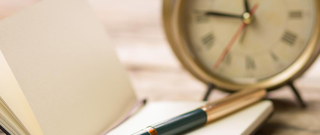 effective time management tips clock with journal and pen