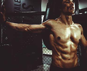 achieve peak physical health man lifting weights