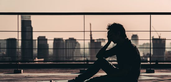 how to deal with depression man sitting on balcony