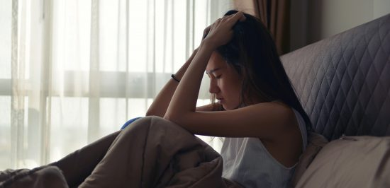 how to get rid of anxiety woman crying hands over head