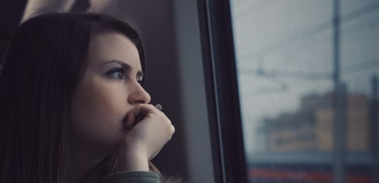 anxiety symptoms girl with sad expression staring out window