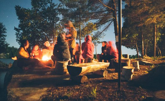 depression symptoms people gathered around a campfire