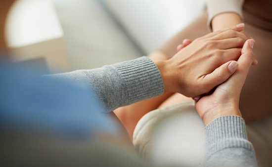 how to help others with anxiety two people holding hands
