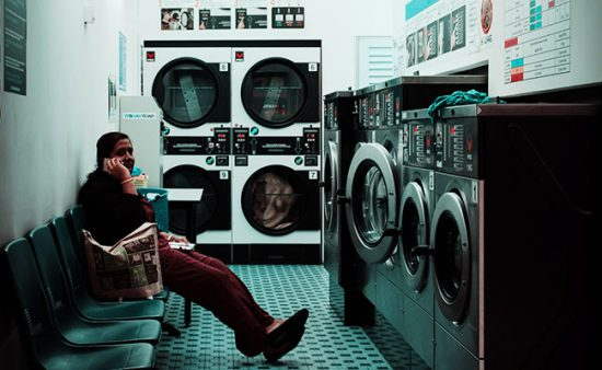 person sitting at laundromat
