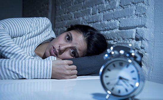 anxiety symptoms woman staring at clock