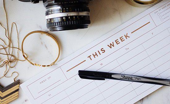 productivity desk with a calendar and camera