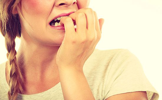 how to deal with anxiety woman biting nails