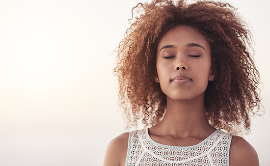importance of health woman breathing with eyes closed