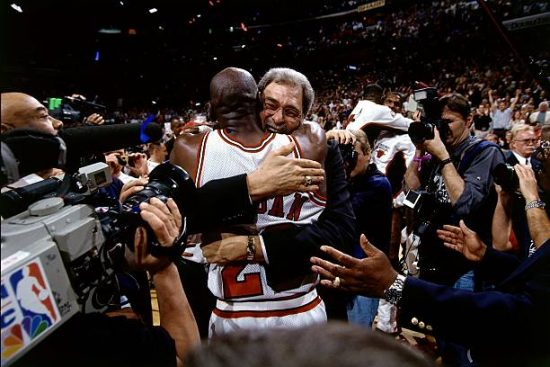 Coach Phil Jackson hugs Michael Jordan