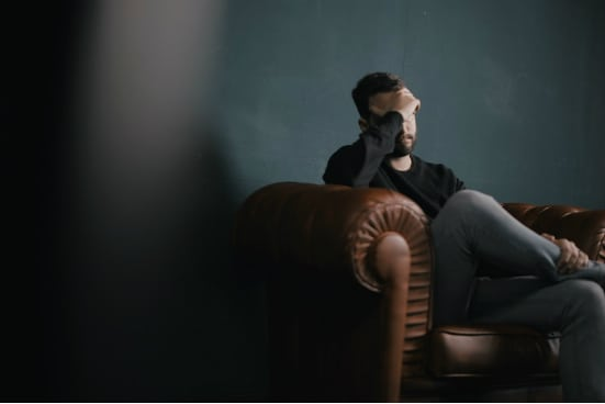depressed-man-on-couch