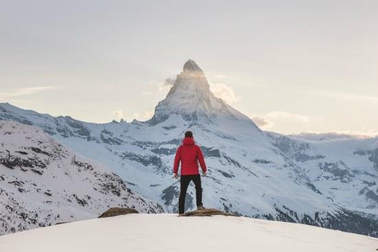 man on top of snowy mountain