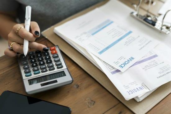 woman calculating profit margins