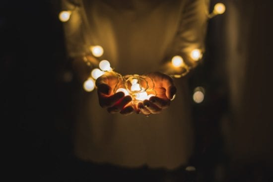 a man holding bulbs in his hands
