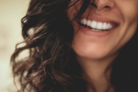 a long haired smiling woman