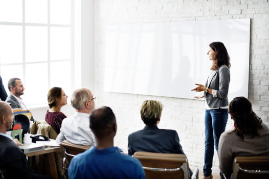 work with a business coach to grow your business